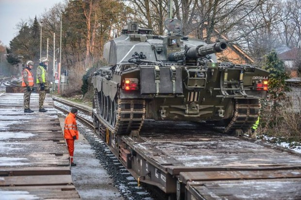 Soldiers from the Queen's Royal Hussars are conducting a major live-firing exercise at the Hohne ranges in Germany. The exercise is part of regiment's annual training, which also involves the transportation of heavy armour. Pictured, a Challenger 2 Main Battle Tank being loaded on to train transports in Sennelager. [Picture: Corporal Mark Webster RLC, Crown copyright]