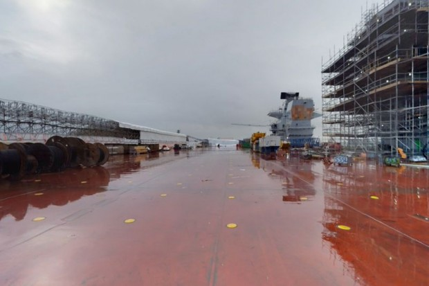 HMS Queen Elizabeth is the first new carrier in the British fleet in over 20 years and the biggest one ever built in the UK. Click here to see a 360° photograph showing the flight deck, which is approximately the same size as 2.5 football pitches. [Picture: Crown copyright]