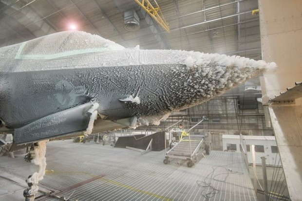 For the past 4 months, an F-35B Lightning II has endured extreme weather temperatures to certify that the fleet is able to deploy to any corner of the world. Pictured, an icing cloud test calibration fixture is placed in front of an F-35B Lightning II aircraft as it undergoes ice evaluation testing at the 96th Test Wing's McKinley Climatic Laboratory at Eglin Air Force Base, Florida. [Picture: Michael D. Jackson, F-35 Integrated Test Force]