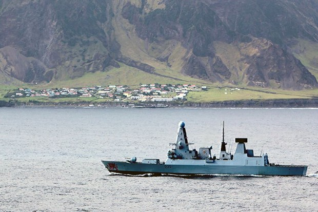 Type 45 destroyer HMS Dragon has called at Tristan da Cunha during a routine 7-month Atlantic Patrol Tasking. The nearest inhabited locality is 1,510 miles away and with no airfield the volcanic isle, home to 257 British citizens, can only be reached by sea. With a small harbour the island is not able to accommodate an 8,500-tonne warship, so the Portsmouth-based destroyer used her sea boats and Lynx helicopter to ferry personnel and supplies from ship to shore. The ship's Lynx also lifted fence posts to otherwise inaccessible parts of the island to help keep cattle from straying during her 24-hour visit. [Picture: Crown copyright]