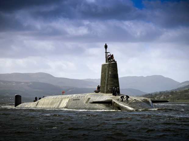 Royal Navy Vanguard Class submarine HMS Vigilant returning to HMNB Clyde after her extended deployment. The four Vanguard-class submarines form the UK's strategic nuclear deterrent force. Each of the the four boats is armed with Trident 2 D5 nuclear missiles. Like all submarines the Vanguard Class are steam powered, their reactors converting water into steam to drive the engines and generate electricity.