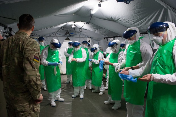 Medics are given a brief on correct use of Personal Protective Equipment.
