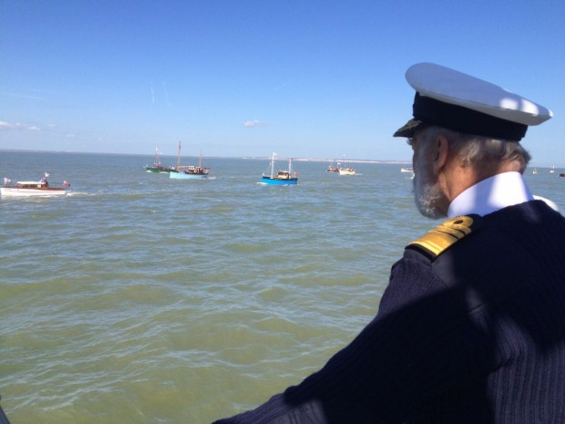 HRH Prince Michael of Kent, Honorary Admiral of Association of Dunkirk Little Ships, views the Dunkirk 75 flotilla from the HMS Trumpeter