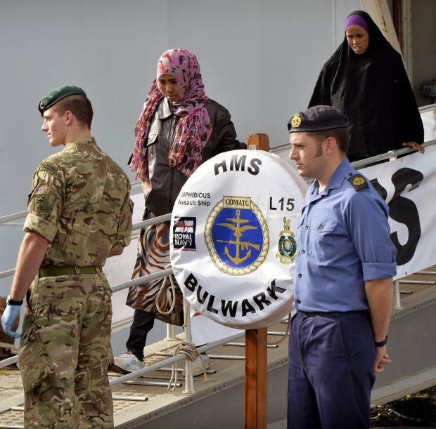 Migrants safely disembarking to Sicily from HMS Bulwark today. 14 May 2015.