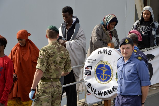 Migrants safely disembarking in Sicily from HMS Bulwark, yesterday 14 May 2015.