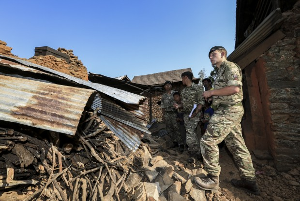 Gurkhas witness the destruction left behind by the earthquake in Nepal a month ago today.