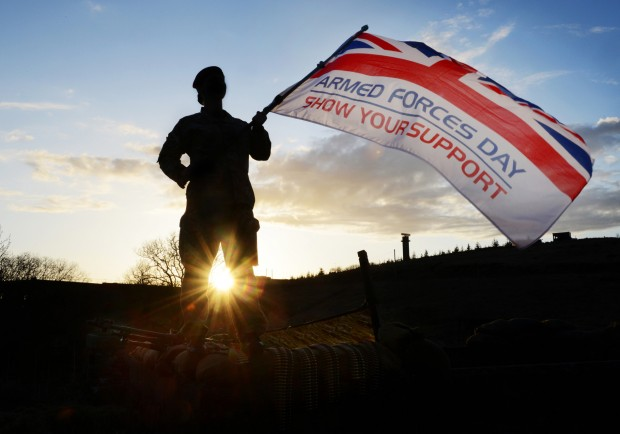 Soldier Waving Armed Forces Day Flag