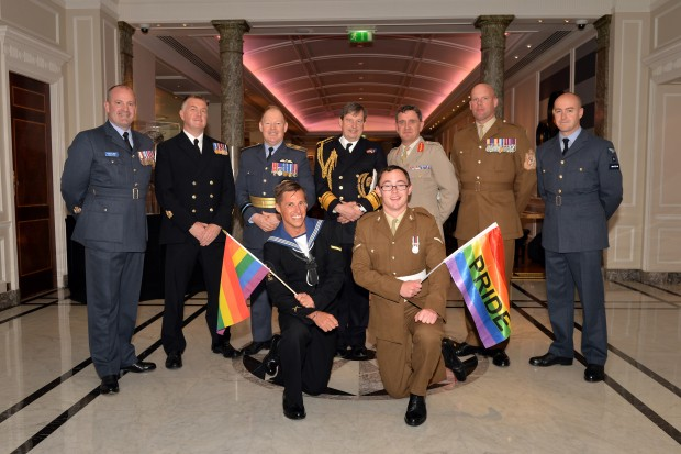 Second Sea Lord Jonathan Woodcock (centre rear), flanked by Air Vce Marshal David Stubbs (to left) and Lieutenant General James Everard (to right) with the Warrant Officers of the three services and personnel from the services contingents prior to the London Community Pride parade. Armed Forces March in London Pride 270615 The Armed Forces marched through the streets of London today on Armed Forces Day as part of the London Community Pride parade. Prior to the event participants met with the Minister of the Armed Forces Penny Mordaunt MP and the Minister for Equalities Incumbent Caroline Dinenage MP as well as a number of Senior Military Officers at the Hyatt Regency Hotel in London. Image taken by LA(Phot) Simmo Simpson, FRPU(E), Royal Navy. Consent forms where required held by FRPU(E), HMS Excellent.
