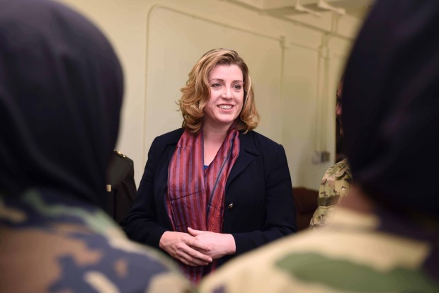 Pictured: Armed Forces Minister Penny Mordaunt MP, meeting female cadets at the Afghan National Army Officer Academy (ANAOA) in Kabul.    Afghanistan's future security will be boosted by the work of the country's first female officer cadets, Britain's first female Armed Forces minister has said.    During her first overseas ministerial visit Penny Mordaunt MP witnessed the graduation of the cadets at the Afghan National Army Officer Academy (ANAOA) in Kabul today.    Since the end of combat operations in October, the focus of the UK's efforts in the country has been training and advising the Afghan National Defence and Security Forces (ANDSF), including leading the mentoring of Afghan instructors at the ANAOA.    The new female and male officers are the third intake of cadets to graduate since the academy opened in October 2013. Demonstrating the strength of performance, a female officer received the Duntroon Sword award for best cadet. Since the end of combat Operations in 2014, approximately 470 UK service personnel have remained in Afghanistan in non-combat roles assisting the Afghan government and Afghan National Defence and Security Forces (ANDSF).  As well as meeting Captain Thomas Bevan, a mentor at the ANAOA from her Portsmouth North constituency, Ms Mordaunt met the female officers after the graduation and saw the new accommodation buildings they have been based in. Later she visited 1 Royal Anglian personnel who are conducting security assistance duties in Kabul. Before arriving in Afghanistan the minister visited Bahrain, where she met Royal Navy personnel based in the Gulf kingdom and saw the new UK maritime headquarters building.