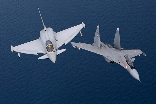 A Royal Air Force Typhoon and an Indian Air Force Flanker flying together on Exercise Indra Dhanush. Royal Air Force and Indian Air Force (IAF) aircraft are 'dogfighting' in a major airpower training exercise in the skies above Britain. For Exercise Indradanush the IAF has flown their Russian built Flanker jet fighters, along with transport and tanker aircraft, across three continents to train with their RAF counterparts. Designed to reinforce the strategic relationship and enhance the mutual operational understanding between the two air forces, pilots and ground forces from both nations are participating in a series of increasingly complex training scenarios.