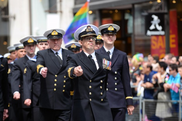 The Royal Navy contingent march through London during the London Community Pride parade. Armed Forces March in London Pride 270615 The Armed Forces marched through the streets of London today on Armed Forces Day as part of the London Community Pride parade. Prior to the event participants met with the Minister of the Armed Forces Penny Mordaunt MP and the Minister for Equalities Incumbent Caroline Dinenage MP as well as a number of Senior Military Officers at the Hyatt Regency Hotel in London. Image taken by LA(Phot) Simmo Simpson, FRPU(E), Royal Navy. Consent forms where required held by FRPU(E), HMS Excellent.