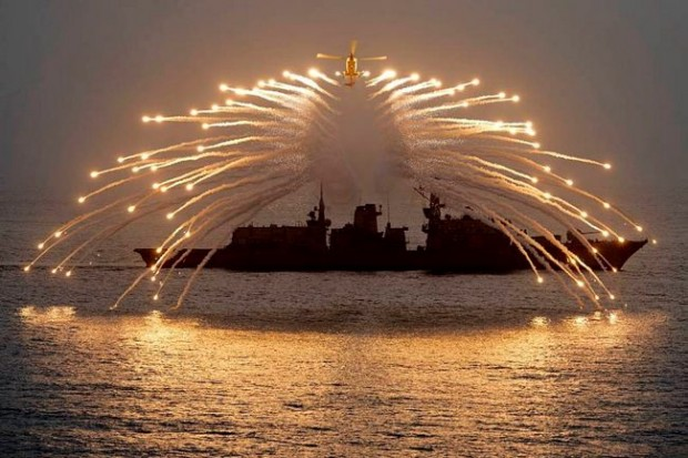The Lynx helicopter from 815 Squadron, Royal Naval Air Station Yeovilton, lit up the night sky with her decoy flares as part of an exercise in the Indian Ocean. The helicopter is on a nine-month deployment to the Gulf with HMS Richmond – a Portsmouth-based Type 23 frigate which is silhouetted in the background.