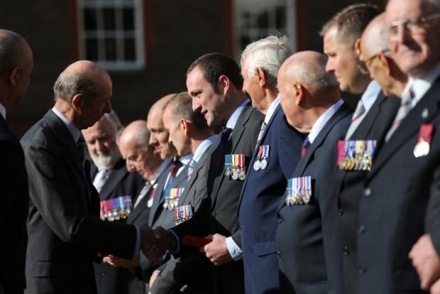 Duke of Kent giving Chris Finney GC his commemorative coin set