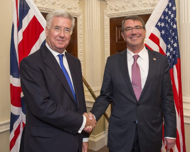 Pictured: L-R: Michael Fallon and Ashton Carter meet at the Ministry of Defence Main Building in London. Visit by US Secretary of Defence, Ashton Carter, visits Secretary of State for Defence, Michael Fallon at the Ministry of Defence in London.