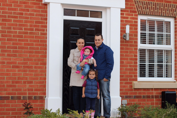 Daye family outside their new home