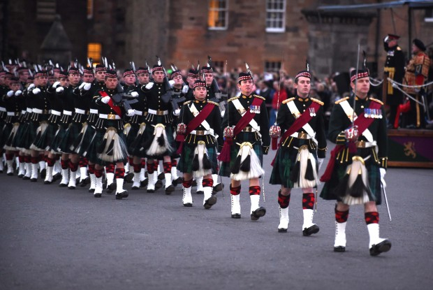 Soldiers and Officers of the Royal Regiment of Scotland march off parade into the Castle in Edinburgh.