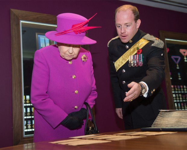 Pictured: HM The Queen views a historical log within the newly opened Medal Office Briefing Room, on Thursday 5th November 2015 on a visit to Imjin Barracks, Gloucester. The Queen visited the the Defence Business Service (DBS) and the Headquarters of NATO's Allied Reaction Corps (HQ ARRC) at Imjin Barracks, Gloucester. During Her Majesty's visit to Innsworth House on the base, the Queen also opened a new briefing room at the MOD's Joint Casualty and Compassionate Centre (JCCC) and the MOD Medal Office (MODMO). The Queen was given a tour of MODMO which assesses, engraves and issues awards of all UK military and selected civilian medals to serving personnel, veterans and their next of kin. The Queen was introduced to staff who prepare and engrave medals and honours for dispatch to recipients across the UK and worldwide. MODMO also uses the Elizabeth Cross to the next of kin of Armed Forces personnel who die on operations or killed by acts of terrorism. The Queen was introduced to members of the Brynin family, relatives of Lance Corporal James Brynin who was killed on operations in the Nahr-e-Sarah area of Afghanistan on 15 October 2013. The Queen toured the JCCC, MOD's permanently manned operational centre for casualty administration, the notifying of a casualty's next of kin and requests for overseas compassionate travel for members of the British Armed Forces serving overseas, anywhere in the world. Her Majesty met the team who assist braved families deal with the administrative challenges following a death, such as wills, and visited the Commemorations Team that manages the delicate process of caring for identifying and finally laying to rest the human remains of fallen heroes from pervious campaigns from as far back as WW1. If possible the team also traces the surviving family members of the deceased. The Queen was then invited to officially open the MODMO and the JCCC's new briefing room at Innsworth House, where she unveiled a plaque to mark the occasion.