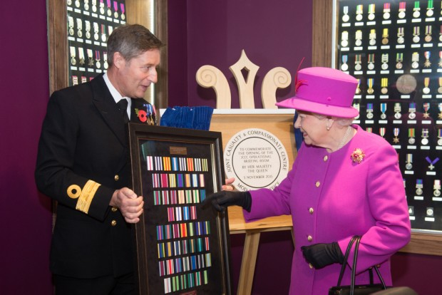 The Queen visited the the Defence Business Service (DBS) and the Headquarters of NATO's Allied Reaction Corps (HQ ARRC) at Imjin Barracks, Gloucester. During Her Majesty's visit to Innsworth House on the base, the Queen also opened a new briefing room at the MOD's Joint Casualty and Compassionate Centre (JCCC) and the MOD Medal Office (MODMO). The Queen was given a tour of MODMO which assesses, engraves and issues awards of all UK military and selected civilian medals to serving personnel, veterans and their next of kin. The Queen was introduced to staff who prepare and engrave medals and honours for dispatch to recipients across the UK and worldwide. MODMO also uses the Elizabeth Cross to the next of kin of Armed Forces personnel who die on operations or killed by acts of terrorism. The Queen was introduced to members of the Brynin family, relatives of Lance Corporal James Brynin who was killed on operations in the Nahr-e-Sarah area of Afghanistan on 15 October 2013. The Queen toured the JCCC, MOD's permanently manned operational centre for casualty administration, the notifying of a casualty's next of kin and requests for overseas compassionate travel for members of the British Armed Forces serving overseas, anywhere in the world. Her Majesty met the team who assist braved families deal with the administrative challenges following a death, such as wills, and visited the Commemorations Team that manages the delicate process of caring for identifying and finally laying to rest the human remains of fallen heroes from pervious campaigns from as far back as WW1. If possible the team also traces the surviving family members of the deceased. The Queen was then invited to officially open the MODMO and the JCCC's new briefing room at Innsworth House, where she unveiled a plaque to mark the occasion. The room will be used to brief service personnel on the actions they need to take before overseas deployments to help JCCC support their families in the event of an incid