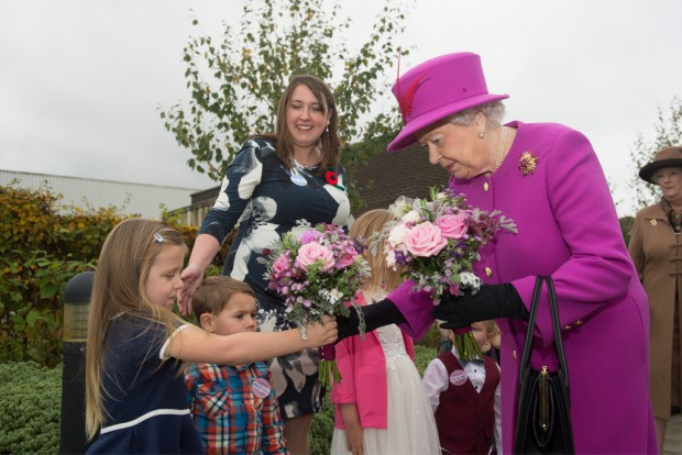 Pictured: HM The Queen receives posies of flowers from children on Thursday 5th November 2015 on a visit to Imjin Barracks, Gloucester. The Queen visited the the Defence Business Service (DBS) and the Headquarters of NATO's Allied Reaction Corps (HQ ARRC) at Imjin Barracks, Gloucester. During Her Majesty's visit to Innsworth House on the base, the Queen also opened a new briefing room at the MOD's Joint Casualty and Compassionate Centre (JCCC) and the MOD Medal Office (MODMO). The Queen was given a tour of MODMO which assesses, engraves and issues awards of all UK military and selected civilian medals to serving personnel, veterans and their next of kin. The Queen was introduced to staff who prepare and engrave medals and honours for dispatch to recipients across the UK and worldwide. MODMO also uses the Elizabeth Cross to the next of kin of Armed Forces personnel who die on operations or killed by acts of terrorism. The Queen was introduced to members of the Brynin family, relatives of Lance Corporal James Brynin who was killed on operations in the Nahr-e-Sarah area of Afghanistan on 15 October 2013. The Queen toured the JCCC, MOD's permanently manned operational centre for casualty administration, the notifying of a casualty's next of kin and requests for overseas compassionate travel for members of the British Armed Forces serving overseas, anywhere in the world. Her Majesty met the team who assist braved families deal with the administrative challenges following a death, such as wills, and visited the Commemorations Team that manages the delicate process of caring for identifying and finally laying to rest the human remains of fallen heroes from pervious campaigns from as far back as WW1. If possible the team also traces the surviving family members of the deceased. The Queen was then invited to officially open the MODMO and the JCCC's new briefing room at Innsworth House, where she unveiled a plaque to mark the occasion. The room will be used to brief se
