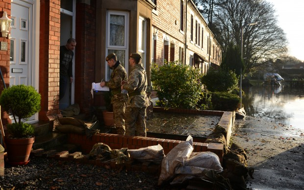Image: Soldiers from 2nd Battalion The Duke of Lancasters Regiment (2 LANCS) helping the emergency services making sure the locals are all accounted for. Photographer: Corporal Lu Scott (RLC) Date December 7, 2015