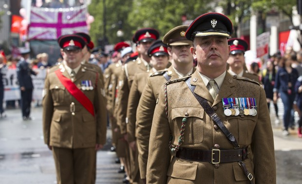"""The British Army has once again proved its commitment to creating an inclusive workplace with its 32nd placing in the 2016 Stonewall Top 100 Employers workplace equality index, a climb of 14 places from last year. Stonewall's Top 100 Employers, now in its twelfth year, is the definitive list of the best employers for lesbian, gay and bisexual staff. And now, for the first time trans-inclusive questions have allowed Stonewall to gather information about what employers are doing to further gender equality in the workplace. Commander Field Army Lieutenant General Sir James Everard said: """"I am delighted that the Army has once more demonstrated the progress it has made as an inclusive employer by achieving its highest-ever ranking within the Stonewall Top 100 Employers. """"I know that much of the credit for this must go to our LGBT Network who works tirelessly to represent the Army's LGBT community and constantly challenge the policy makers and chain of command to do better."""" The survey asks questions covering key indicators of workplace culture, whilst the index's criterion explores ten areas of employment policy and practice. To supplement evidence submitted by employers, Stonewall also seeks feedback directly from the entrant's staff. The feedback is sent directly to Stonewall and is anonymous. Warrant Officer Karen Styles, Army LGBT Forum Chair, said: """"As the Chair of the Army LGBT Forum I am extremely pleased with placing as a Stonewall Top 100 Employer for the 3rd consecutive year. This has shown that through the dedication of the whole forum team we have continued to educate and mentor formations and individuals within the Chain of Command on the importance of having a truly diverse workplace"""". Soldiers wait to step off on parade during the 2014 London Pride event."""