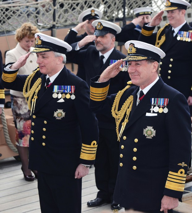 ADMIRAL SIR PHILIP JONES REFLECTS ON NAVY'S BRIGHT FUTURE AS HE TAKES OVER AS FIRST SEA LORD FROM ADMIRAL SIR GEORGE ZAMBELLAS Pictured - Admiral Sir George Zambellas right and Admiral Sir Philip Jones. The torch of Naval leadership today [Friday April 8] changed hands as Admiral Sir Philip Jones took over as Britain's senior sailor and his predecessor, Admiral Sir George Zambellas, stepped down after 35 years' serving his nation. In the great cabin of the world's oldest commissioned warship, HMS Victory, Admiral Zambellas formally handed over command of more than 30,000 men and women, nearly 90 warships, nuclear submarines and support vessels, the helicopters and jets of the Fleet Air Arm and the elite Naval infantry of the Royal Marines to the man who has overseen the day-to-day operations of the Royal Navy since 2013 as its Fleet Commander. During his three-year spell in charge, Admiral Jones will oversee the aircraft carrier HMS Queen Elizabeth's entry into service. Her sister ship, HMS Prince of Wales, will begin sea trials and the world's most advanced fifth generation jet aircraft, the F-35B Joint Strike Fighter, will operate from a Royal Navy ship for the first time.