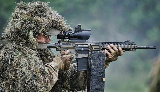 A sniper takes aim at the International Sniper Competition