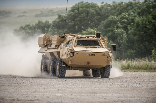 One of the Army's fleet of FUCHS reconnaissance vehicles being put through its paces by Falcon Squadron Royal Tank Regiment. Crown Copyright.