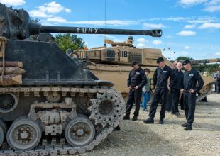 Royal Tank Regiment soldiers admire the tank used in the film 'Fury'.