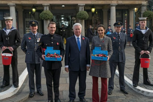 London Poppy Day kicks off in Covent Garden. Pictured left to right (flanked by RAF and Royal Navy collectors) are, Lance Corporal Richard Jones, Defence Secretary Michael Fallon and Soprano Laura Wright. Crown Copyright.
