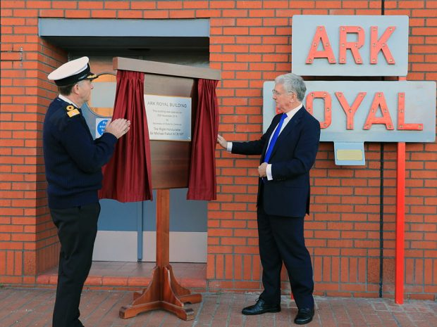 Defence Secretary, The Right Honourable Sir Micaheal Fallon (right) unveils the new plaque at Ark Royal Building in Portsmouth Naval Base with Commodore Jeremy Rigby (left). Defence Secretary Sir Michael Fallon visited Portsmouth today (25 Nov 2016) to view some of the final preparations for the arrival of HMS Queen Elizabeth. Sir Michael toured parts of HM Naval Base Portsmouth to see the progress of the latest work in preparation for the first of the largest warships ever built for the Royal Navy. The Defence Secretary also opened the new Ark Royal building on Princess Royal jetty, which has been set up in support of the new carriers.