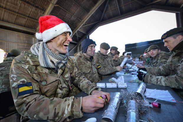 Pictured: Soldiers from 3PWRR about to received their Christmas Lunch from Officers and Senior Non Commissioned Officers.
