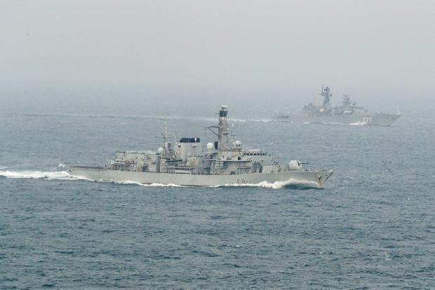 HMS Sutherland, seen here in the foreground, escorting the Yaroslav Mudry, seen in the background.
