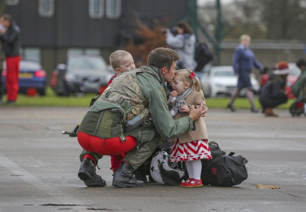 The Red Arrows arrive back at RAF Scampton after their tour of Asia Pacific and the Middle East. Friends and family of the team welcome them home. Flt Lt Tom Bould, Red 7, meets his wife and children after landing.