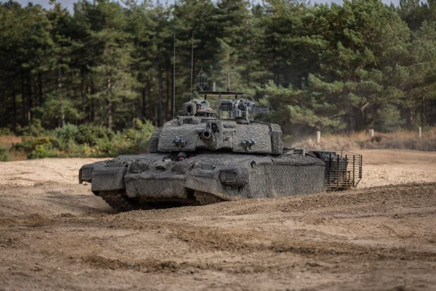 The UK Main Battle Tank, Challenger 2 Theatre Entry Standard (CR2 TES) fitted with a Mobile Camouflage System (MCS). Crown Copyright.