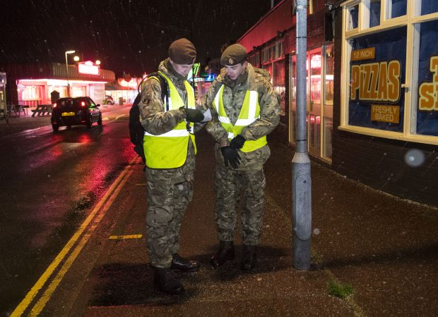 Troops from the Kings Royal Hussars deployed to Hemsby on Friday to warn and inform residents about the threat of coastal flooding.