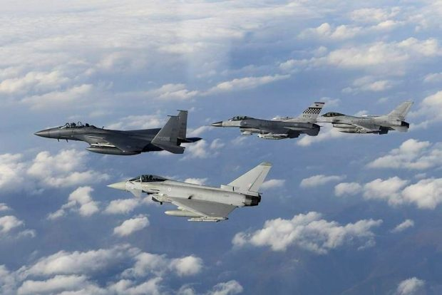 An RAF Typhoon flies with Republic of Korea (RoK) and US aircraft over RoK in 2016
