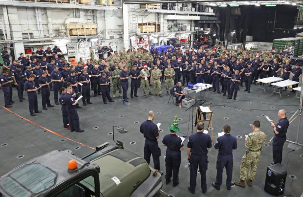 Image of ships company, HMS Ocean singing Christmas carols.
