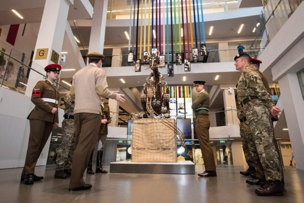 Soldiers look at the Rat Sculpture that is in the centre of the reopened National Army Museum.