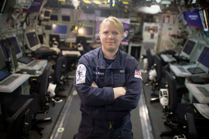 30 year old Leading Seaman Above Water Tactical Warfare Specialist, Kaylie Yates frm Broadstairs, poses for a photograph in the operations room on board HMS St Albans on March 7, 2017 in London, England. HMS St Albans is a Type 23 frigate of the Royal Navy. In 2006 she took a six-month deployment to the Gulf region to protect the Iraqi oil platforms and patrol duties in the Gulf. Members of her female crew have been invited to 10 Downing Street to a reception for International Women's day hosted by the Prime Minister, Theresa May.