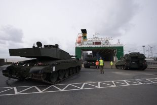 An AS90 and a Challenger 2 tank being loaded onto cargo ship in the port of Emden, Germany, before deployment to Estonia.