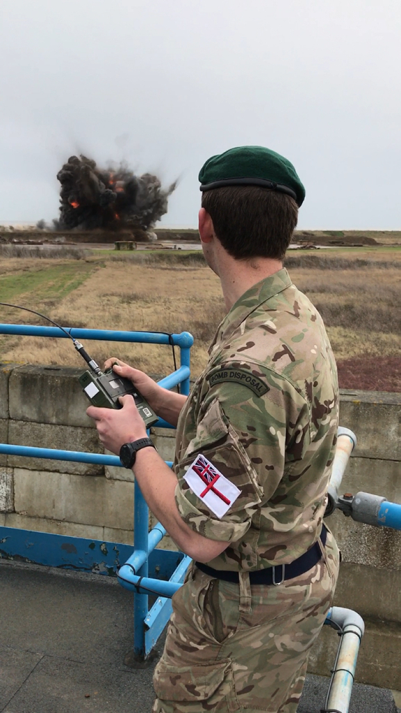 Image shows a Royal Navy Bomb Disposal expert, detonating the German WWII SC 500lb bomb. After a long, cold night of expert and cautious work at the Brondesbury Park building site near Brent, rendering the fuse safe on the German WW2 SC 500lb air dropped bomb yesterday, the Army's Royal Engineers were relieved to hand over the ultimate disposal of the 500lb explosive to a four-man Royal Navy Team from the SOUTHERN DIVING UNIT (2) based in Horsea Island, Portsmouth. The Royal Navy team made a controlled demolition of the WW2 ordnance at Shoeburyness Range near Southend, Essex at 1130am on Saturday morning (4 March 17). AB (Diver) Liam Boardman initiated the demolition of the bomb, supported by the Navy's team of duty Mine Clearance Divers, led by Petty Officer Diver Craig Waghorn and including Leading Diver Matthew Smark and AB Diver Steve Lundsten who travelled up last night from their Hampshire base to assist the Army team.