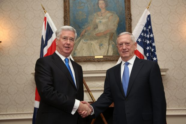 Secretary Sir Michael Fallon shaking hands with US Secretary of Defense Jim Mattis inside the Ministry of Defence.