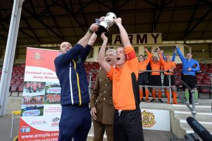 Members of 154 (Scottish) Regiment RLC celebrate winning the Army Reserves Challenge Cup Final on Saturday.