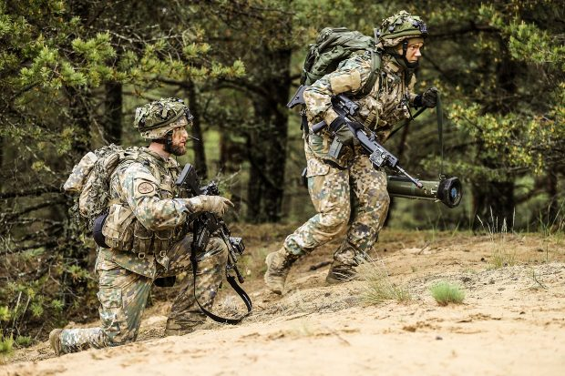 Latvian soldiers defending their positions in a simulated attack by other NATO allies. X Ray Company of Arbroath based 45 Commando Royal Marines are currently deployed in the Baltics participating in a large scale NATO exercise, known as Sabre Strike. Crown copyright.