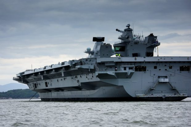 History was made as HMS Queen Elizabeth, the first QE Class aircraft carrier, set sail from Rosyth to commence first stage sea trials off the North-East of Scotland. Crown Copyright.