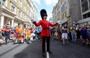 More than 200 Armed Forces and civilian Defence personnel, led by the Band of the Welsh Guards, marched in this year's Pride in London to mark the 50th anniversary of the partial decriminalisation of homosexuality in England and Wales.