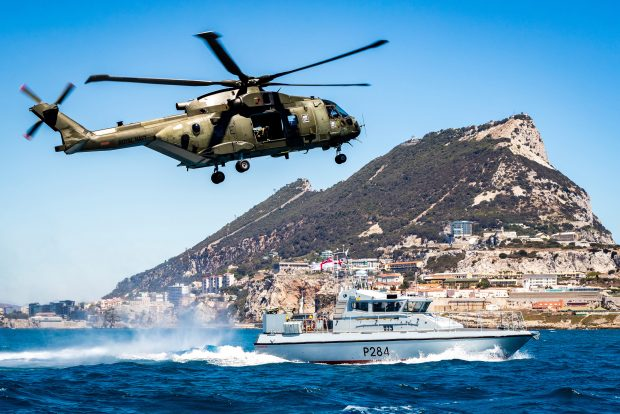 Global Operations Award 2017, awarded to the best single image that is judged to create the most impact portraying the Royal Navy's global maritime responsibilities. Pictured is a Commando Helicopter Force Merlin Mk3 helicopter and HMS Scimitar, a Scimitar Class Fast Patrol Boat, conducting reassurance and demonstration of UK sovereignty in British Gibraltar Territorial Waters. Crown copyright.
