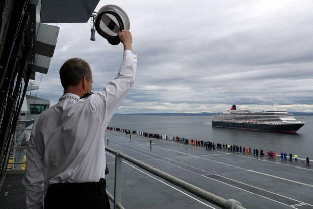 HMS Queen Elizabeth met the Cunard cruise liner MV Queen Elizabeth off the coast of Scotland on 6 July. HMS Queen Elizabeth is currently undergoing sea trials and was at anchor just off the coast of Invergordon.