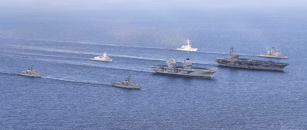 HMS Queen Elizabeth met up with the USS George H W Bush during Exercise Saxon Warrior. Crown copyright.